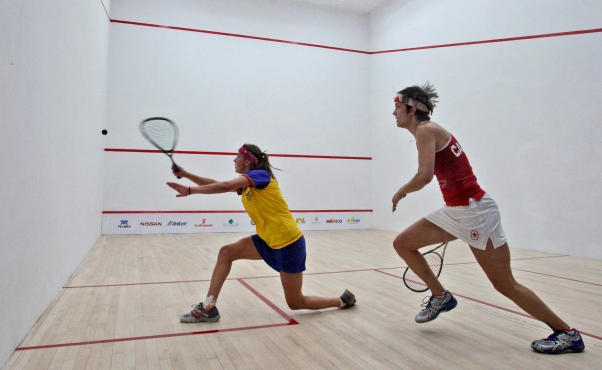 Canada's Samantha Cornett (right) compete in the women's team squash final match at the Pan American Games in Guadalajara, Oct. 21, 2011.