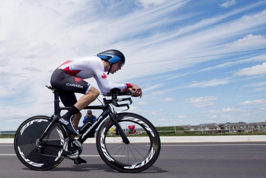 Sean MacKinnon of Canada rides his way to winning the bronze medal in men's individual time trial road cycling at the 2015 Pan Am Games in Milton, Ont.