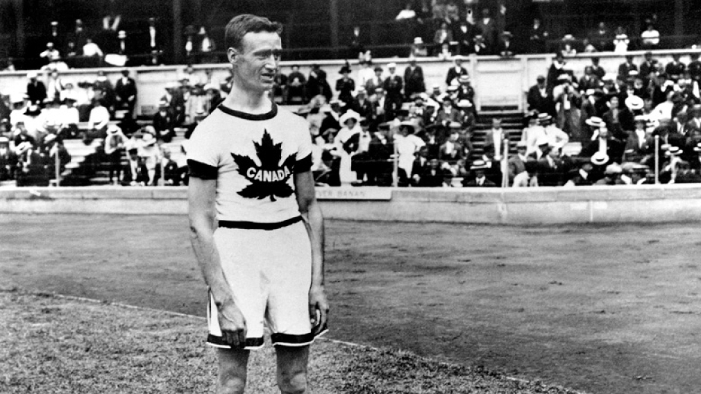 Canadian athlete standing in front of a crowd