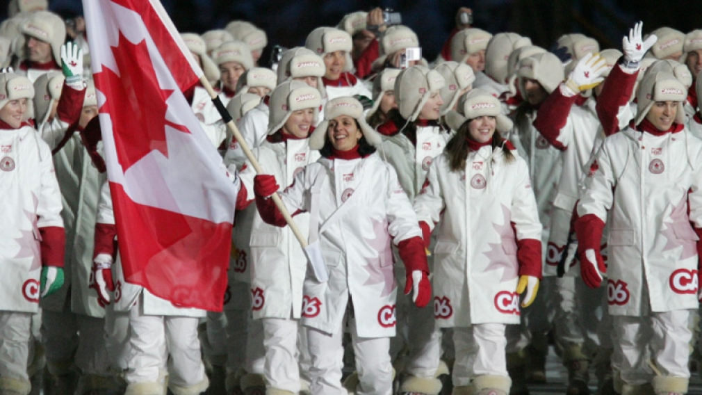 Athletes marching with the Canadian flag