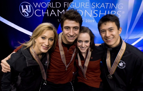 Ladies silver medalist Joannie Rochette, ice dance bronze medalists Scott Moir and Tessa Virtue, and men's silver medalist Patrick Chan, left to right, pose with their medals at the World Figure Skating Championships, Sunday, March 29, 2009 in Los Angeles. THE CANADIAN PRESS/Paul Chiasson