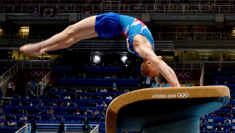 Kyle Shewfelt on vault at Athens 2004