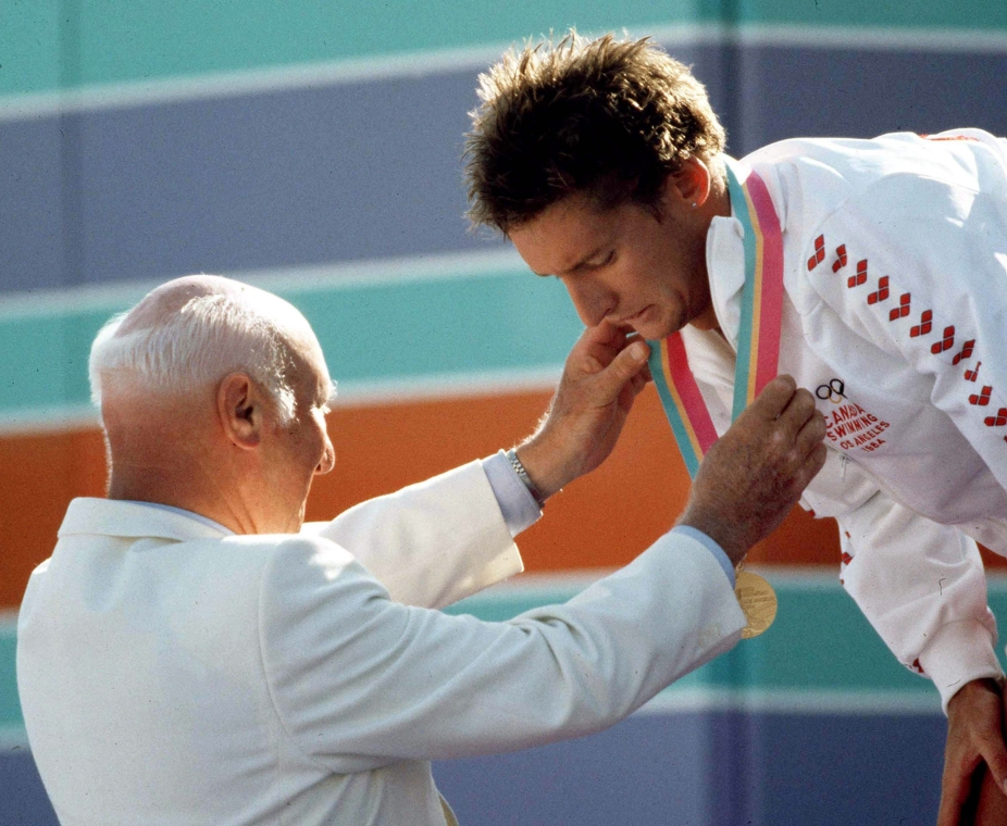 Alex Baumann receives the first of his two gold medals at the Los Angeles Games in 1984.