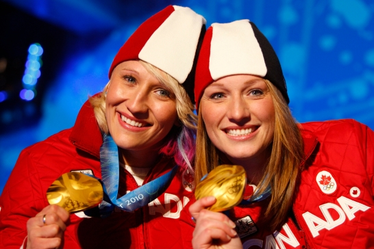 Canadian bobsleigh gold medallists Kaillie Humphries, left, and Heather Moyse pose with their medals at the awards ceremony on Thursday February, 25, 2010 at the Whistler Olympic Park during the 2010 Olympic Winter Games. THE CANADIAN PRESS/Jeff McIntosh