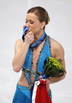 Joannie Rochette kisses her medal as she celebrates bronze at Vancouver 2010