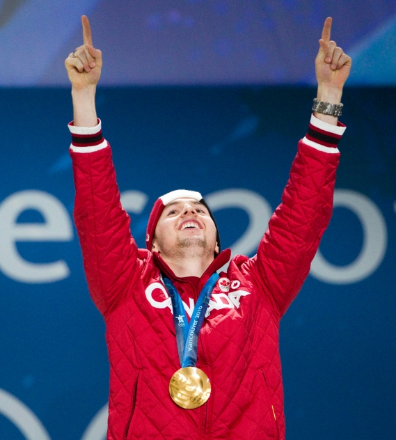 Canada's Alexandre Bilodeau celebrates his gold medal, Canada's first of the games, during a medal ceremony at the 2010 Winter Olympic Games in Vancouver, Monday, Feb. 15, 2010.THE CANADIAN PRESS/Jonathan Hayward