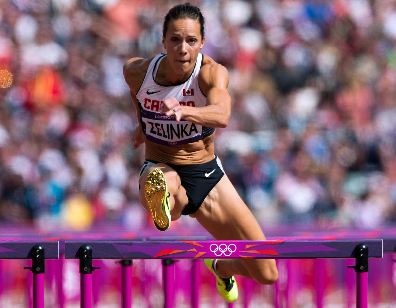 Jessica Zelinka clears the final hurdle during the 100m hurdles portion of Women's Heptathlon at the Olympic Games in London
