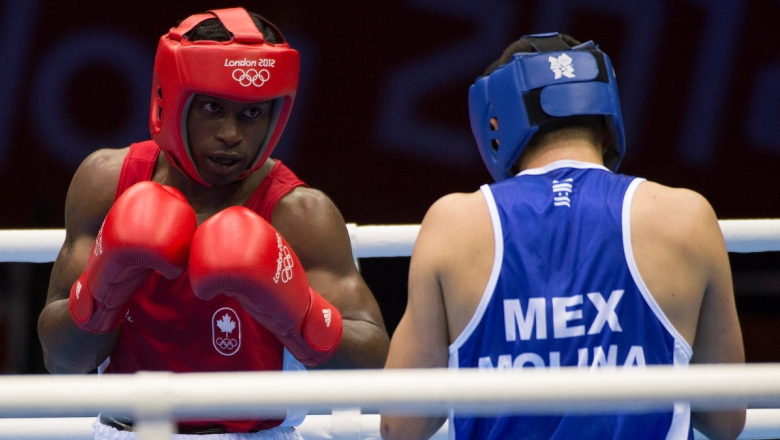 Custio Clayton (left) was Canada's latest Olympic medal hope, however a controversial decision against a British fighter at London 2012 saw him lose a quarterfinal decision.
