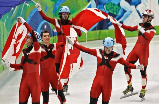 The Canadian men's short track speed skating team Olivier Jean, Guillaume Bastille, Charles Hamelin, Francois - Louis Tremblay and Francois Hamelin,left to right, celebrate their gold medal win February 26, 2010 in the mens's 5000 metre short track relay finals held at the Pacific Coliseum during the 2010 Vancouver Olympic Games. THE CANADIAN PRESS/Tara Walton