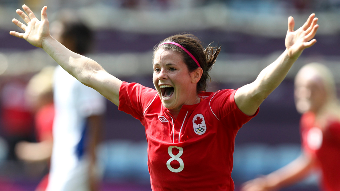 Matheson celebrates with her arms in the air