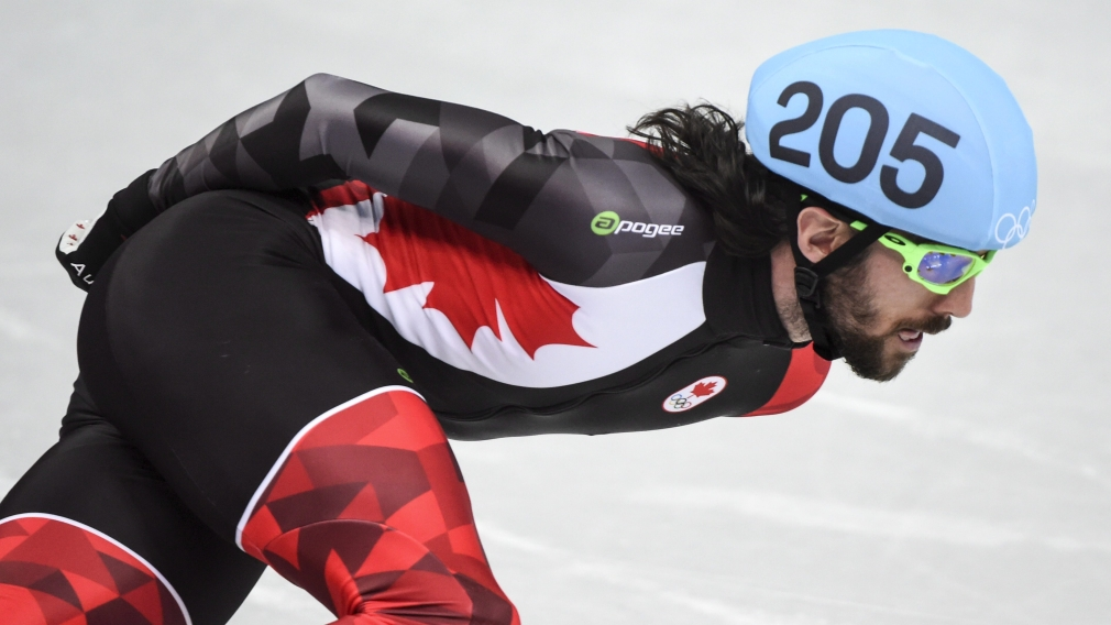Charles Hamelin rounds a corner in the men's 1000 metre speedskating