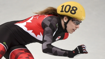 Team Canada - Marianne St-Gelais rounds a corner at the Sochi Winter Olympics