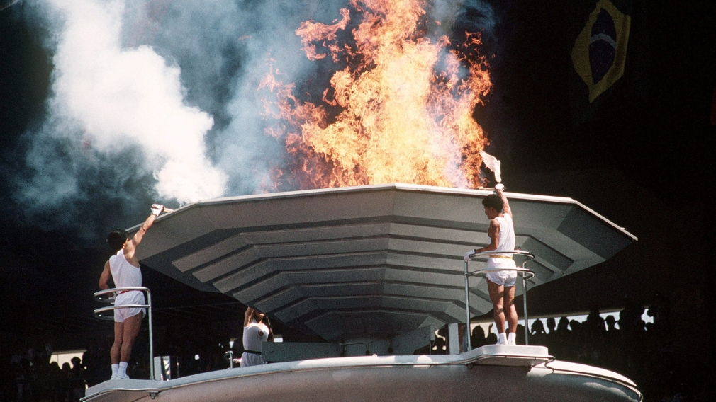 Torch bearers light the Olympic Flame during opening ceremonies at the 1988 Olympic game