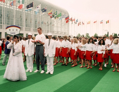 Canada's Romel Raffin (with flag) and the Canadian Olympic Team attend the flag raising ceremony at the 1988 Seoul Olympic Games. (CP PHOTO/COC/ T. Grant)