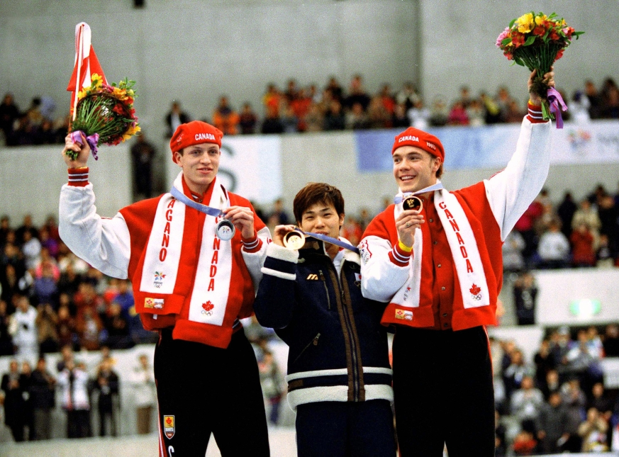 Canadians Jeremy Wotherspoon (left) and Kevin Overland (right) celebrate after winning respectively bronze and silver medals in the 500m long track speed skating event of the Nagano 1998 Olympic Winter Games.(CP PHOTO/COC)