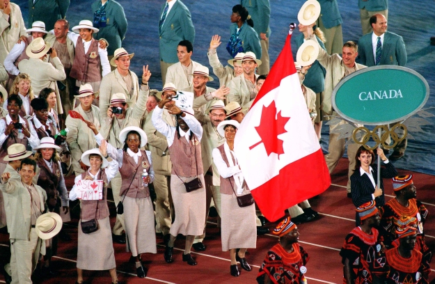 Charmaine Crooks carries Canadian flag at opening ceremony