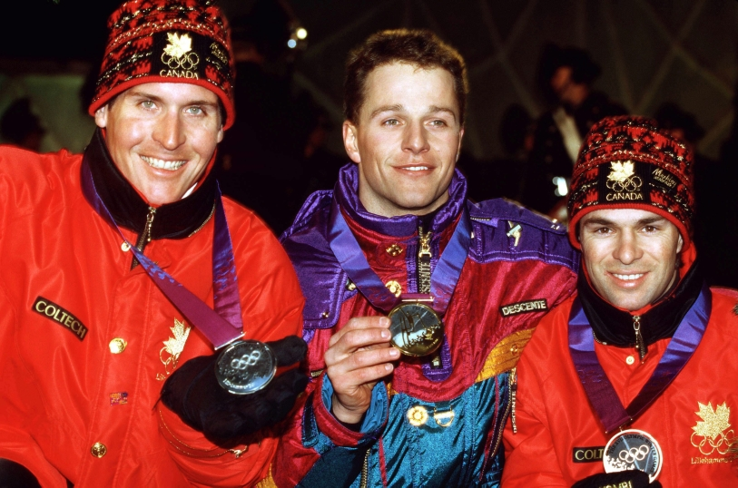 Canada's Philippe Laroche (left) and Lloyd Langlois (right) celebrate after winning respectively silver and bronze medals in the men's freestyle ski aerials event at the Lillehammer 1994 Olympic Winter Games. (CP Photo/ COC/Claus Andersen)