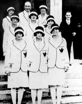 Canadian women athletes pose in suits with maple leaf on chest