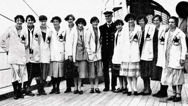 Canadian women stand in uniform on a boat