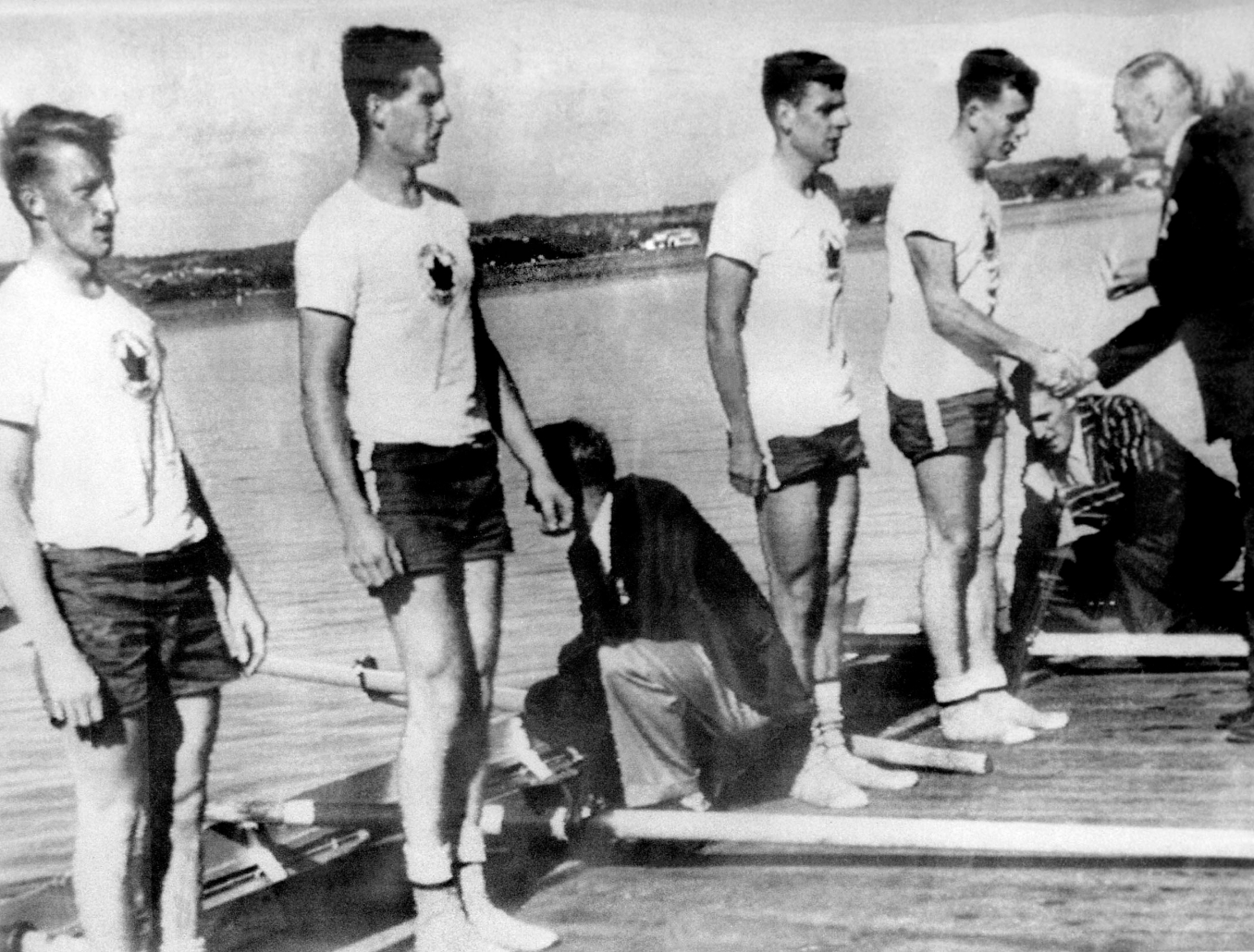 Canada's men's 4x rowing team celebrates its gold medal win at the 1956 Melbourne Olympics. (CP Photo/COC)