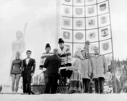 Canada's Barbara Wagner and Robert Paul (centre) celebrate their gold medal in the pairs figure skating event at the Squaw Valley 1960 Olympic Winter Games. (CP Photo/COC)