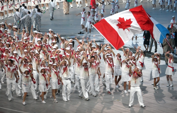 Adam van Koeverden of Toronto leads the Canadian team into the opening ceremony of the Beijing Summer Olympics in Beijing, China, Friday, August 8, 2008. (CP PHOTO)2008(HO-COC-Mike Ridewood)