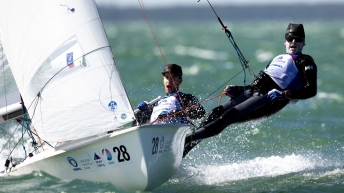 Jacob Saunders and Oliver Bone in the middle of a sailing race