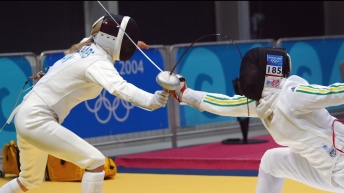 Two fencers in a bout