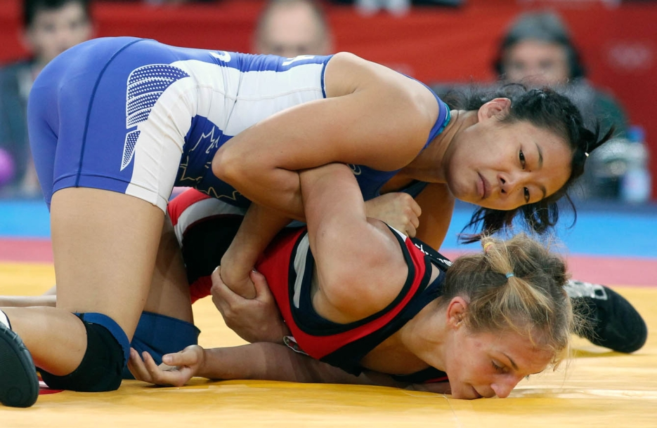Two female wrestlers on the ground