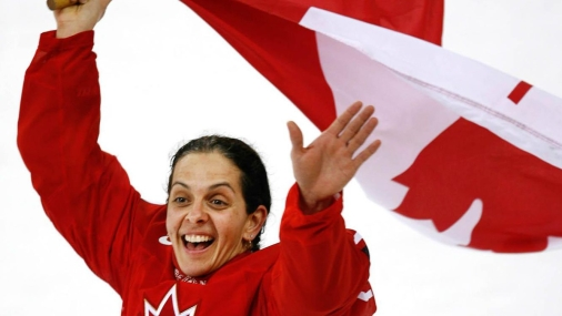Canada's Danielle Goyette celebrate her team's 4-1 victory over Team Sweden to win the gold medal in women's hockey at the Turin 2006 Olympic Winter Games Monday, Feb. 20, 2006 in Turin. (CP PHOTO/Paul Chiasson)