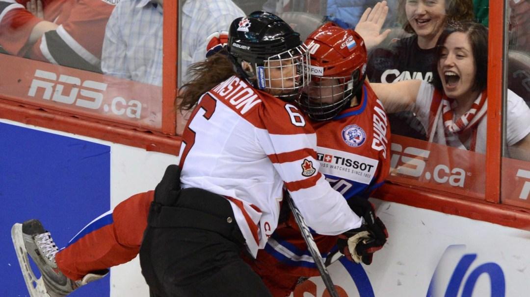Johnston checking an opponent