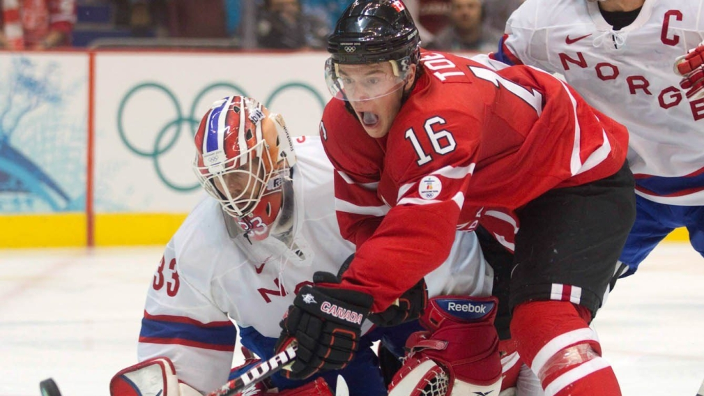 Jonathan Toews, ties to get a shot past Norway's goaltender Pal Grotnes
