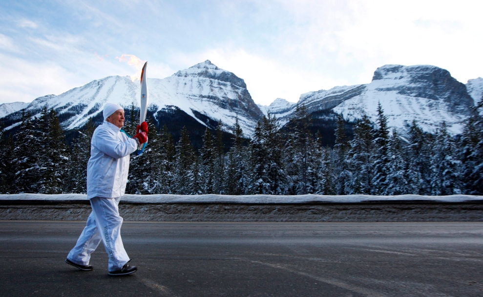 Torchbearer and former Alberta premier Peter Lougheed crosses into British Columbia from Alberta with the Vancouver 2010 Olympic flame