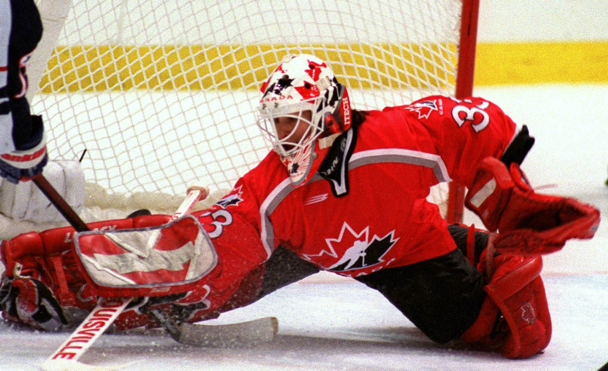 Manon Rheaume saving a shot