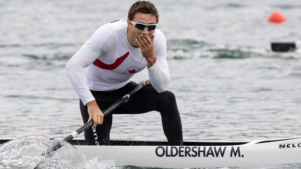 Mark Oldershaw reacts to his bronze medal win on a canoe