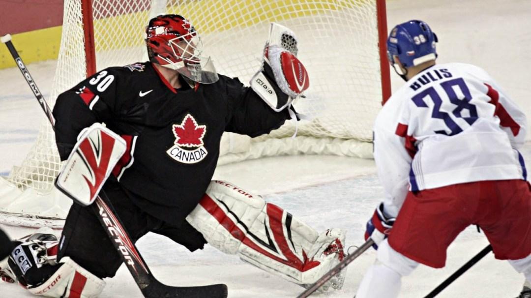 Team Canada goaltender Martin Brodeur makes a glove save