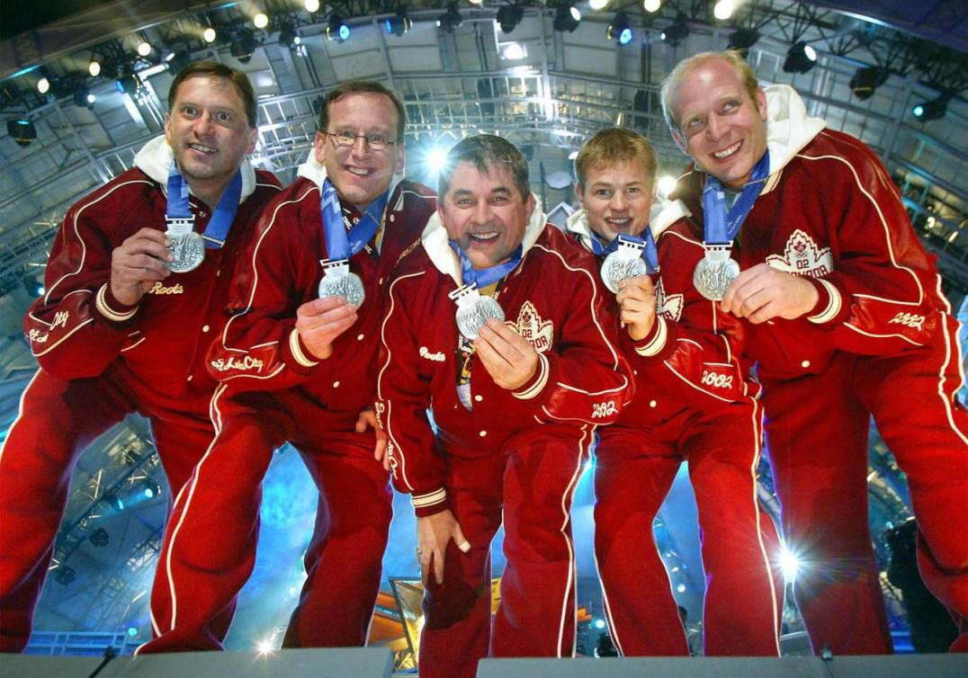 DON WALCHUK, DON BARTLETT, KEN TRALNBERRG, CARTER RYCROFT, KEVIN MARTIN posing with their medals