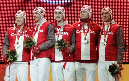Canada's men's long track pursuit team from, left, Jason Parker of Winnipeg, Justin Warsyleweicz of Regina, Denny Morrison of Fort St. John, B.C., Steven Elm of Red Deer, Alta. and Arne Dankers of Calgary pose with their silver medals at the Olympic Winter Games in Turin, Italy, Friday, Feb. 17, 2006. (CP PHOTO/COC/Mike Ridewood)