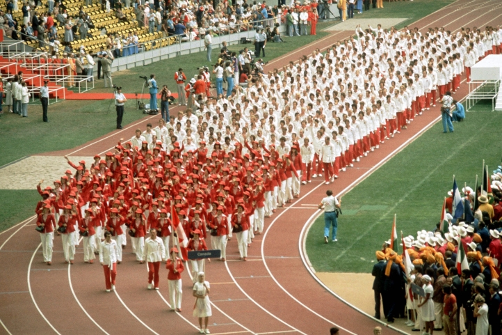 Wide shot of Team Canada walking into opening ceremony