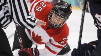 Marie-Philip Poulin waits for the puck to drop