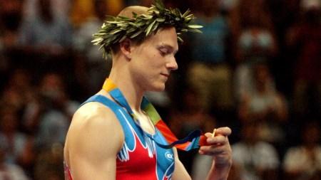 Kyle Shewfelt celebrates a gold medal victory