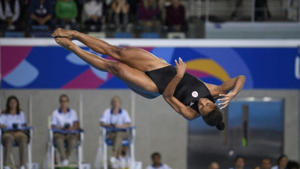 Jennifer Abel twirling during a dive