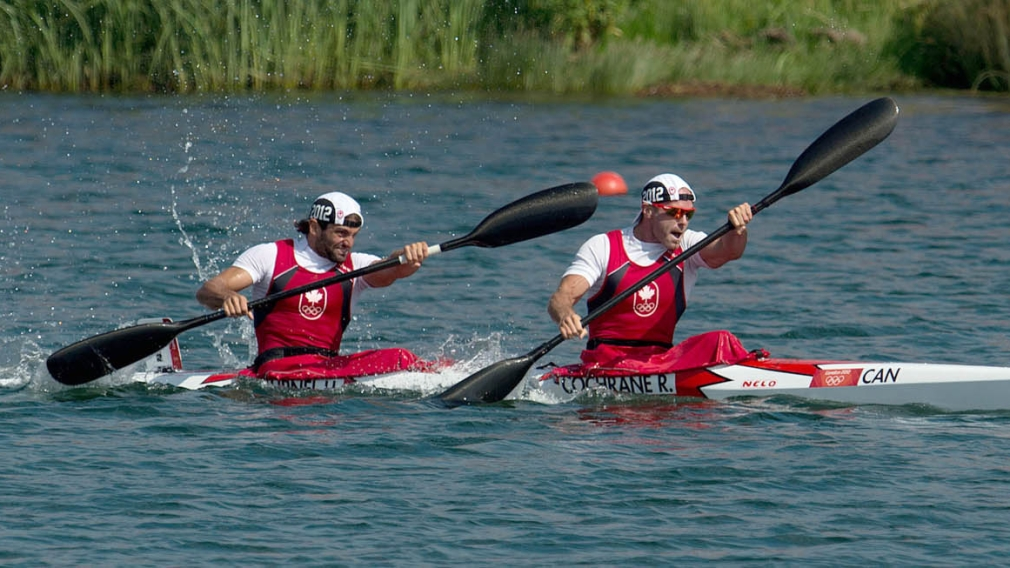 Cochrane and a teammate paddle together during a race
