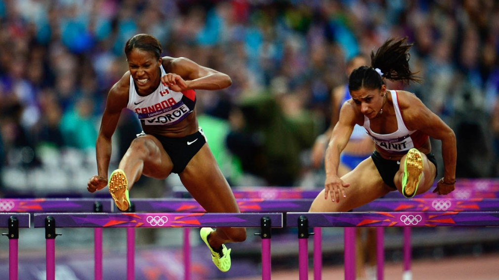 Phylicia George jumping hurdle