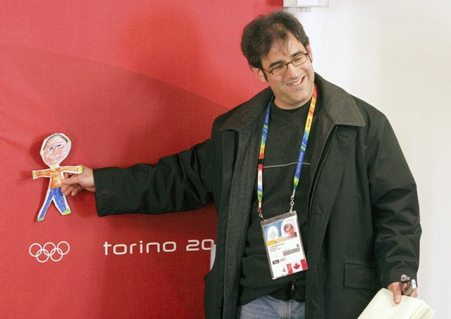 Randy Starkman poses with a drawing of himself at Turn 2006.