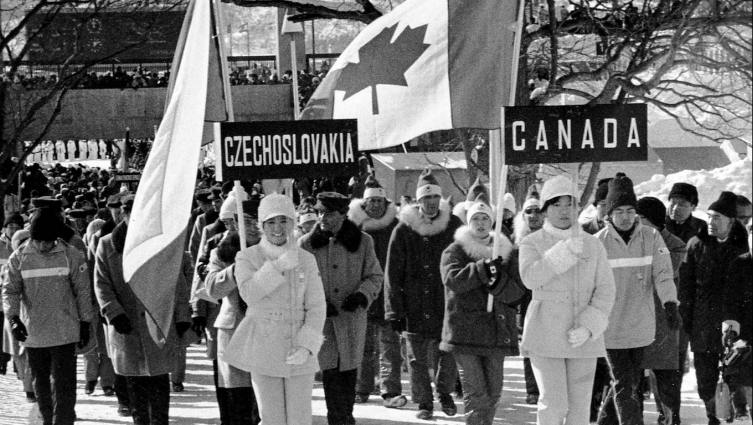 Canada's Karen Magnussen carries the Canadian flag during the opening ceremony of the Sapporo 1972 Olympic Winter Games.