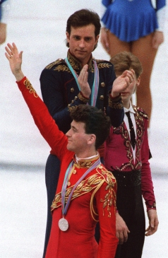 Brian Orser waves as Brian Boitano applauds the silver medallist at Calgary 1988.