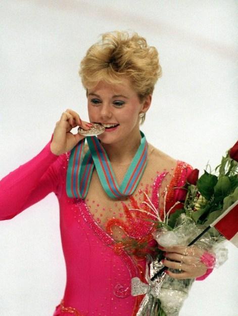 Elizabeth Manley bites the silver medal she won at Calgary 1988.