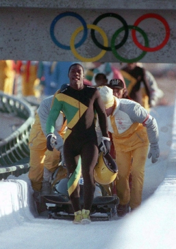 The Jamaican bobsleigh team leaves the track after their final run at Calgary 1988.