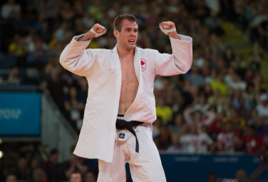 An emotional Antoine Valois-Fortier of Canada, white, celebrates a win over Travis Stevens of the USA for a bronze medal in judo at the 2012 London Olympics, on July 31, 2012. THE CANADIAN PRESS/HO, COC - Jason Ransom